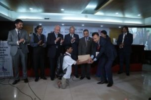 Ratan receiving appointment letter in the job fair jointly organized by Access Bangladesh, BBDN and CAMPE