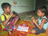 Two deaf children are practicing sign language
