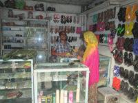 man working in shoe shop