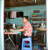 man working with sewing machine