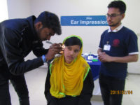doctor checking up a hearing problem patient