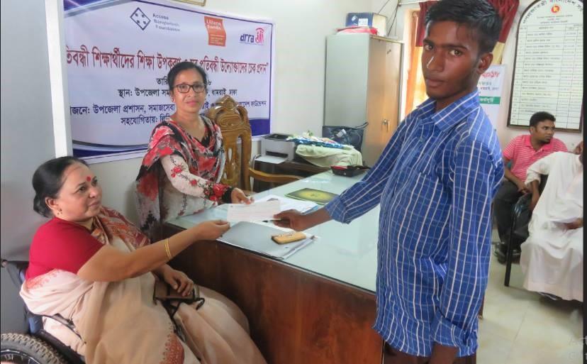 a man is given a cheque as an entrepreneur