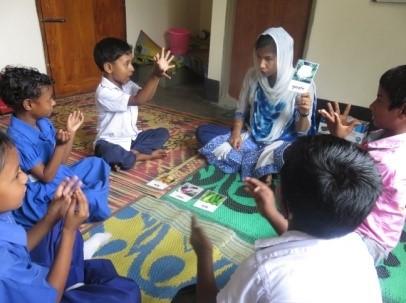 Deaf children practicing sign language