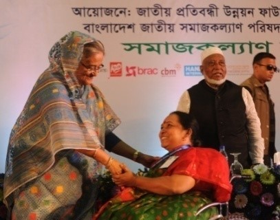Ms. Mohua Paul receiving Disability Card from the Honorable Prime Minister