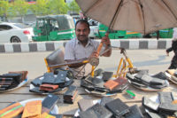 Saleh-is-running-his-leather-goods-shop-in-the-street